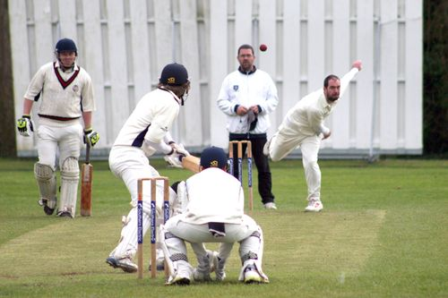 Batsman starting to charge at Resty (shortly before being stumped)